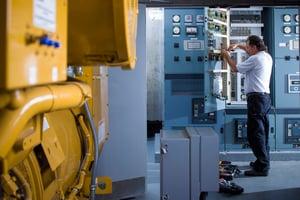 technician servicing diesel generator